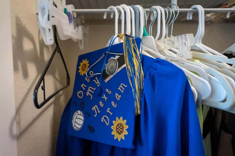 Sierra's graduation cap and gown hangs in her room in Orange County, California. Sierra started high school in 2016 while homeless with her mom and faced daily challenges of finding food, shelter and staying clean to feel normal.