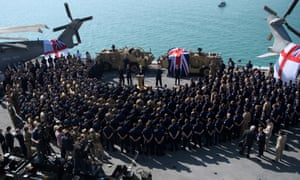 Theresa May addresses sailors on board HMS Ocean during her trip to attend the Gulf Cooperation Council summit in Bahrain.