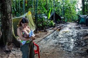 A female Farc guerilla breastfeeding