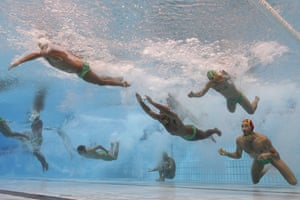 The Australian men's team enters the pool for the water polo quarter-final against Serbia.