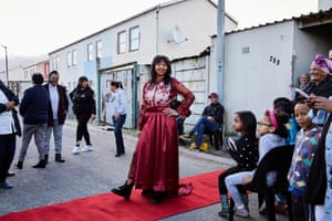 Cleo Paulse, 18, posing on a red carpet at her family home in Hanover Park. She is the eldest of three siblings and the second person in her family, after her mother, to finish high school.