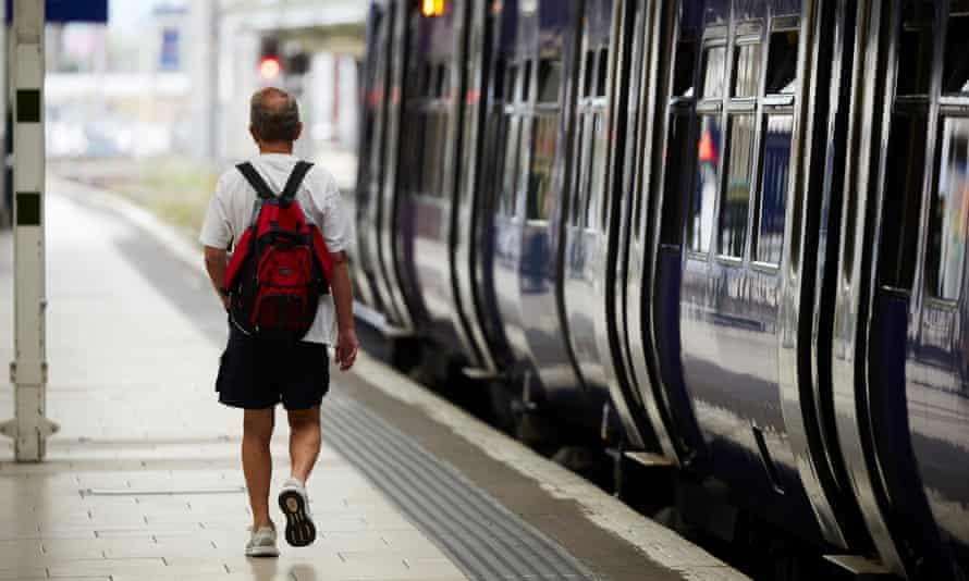 Train passenger  on platform at Manchester Piccadilly station