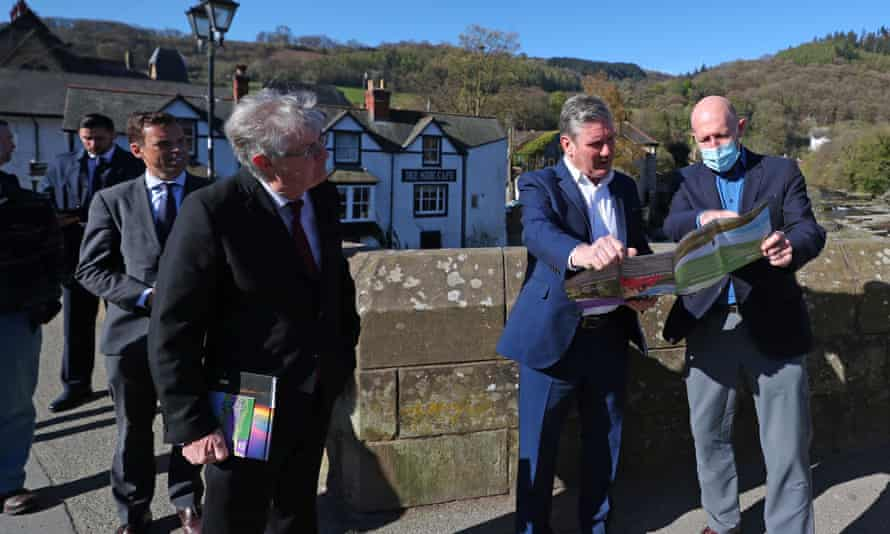 First minister of Wales, Mark Drakeford, with Labour's leader, Keir Starmer, and AONB partnership chair, Andy Worthington, during a walkabout in Llangollen for Welsh Labour's Senedd election campaign