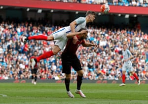 England's John Stones beats Turkey's Cenk Tosun to the ball