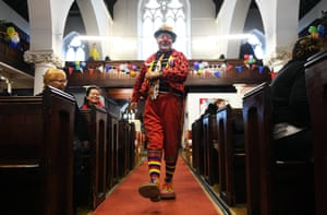 A clown arrives to attend a service for Joseph Grimaldi at All Saints Church in east London