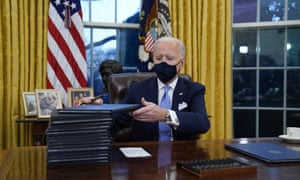 Joe Biden in the Oval Office on his first day as president.