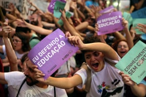 Thousands protest in Rio de Janeiro against education cuts announced by Jair Bolsonaro's government.