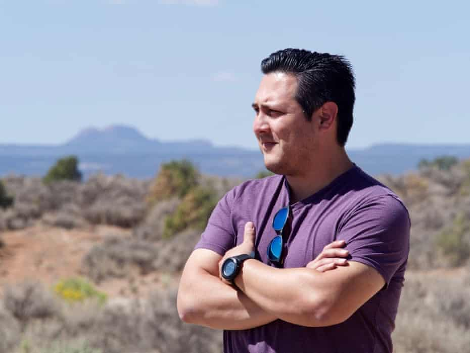 James Courage Singer, Utah's first Navajo candidate for the US House of Representatives, visits the Navajo community of Westwater, near Blanding. The mesa behind him is Bears Ears, for which the monument is named.