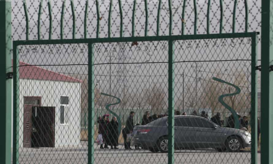 People line up at what the Chinese government says is a vocational training centre in Artux, in western China's Xinjiang region.