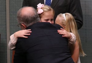 Scott Morrison is congratulated by his daughters, Abbey and Lily, after delivering the 2016 budget speech.
