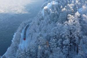 Krasnoyarsk, Russia A train moves along the bank of the Yenisei river