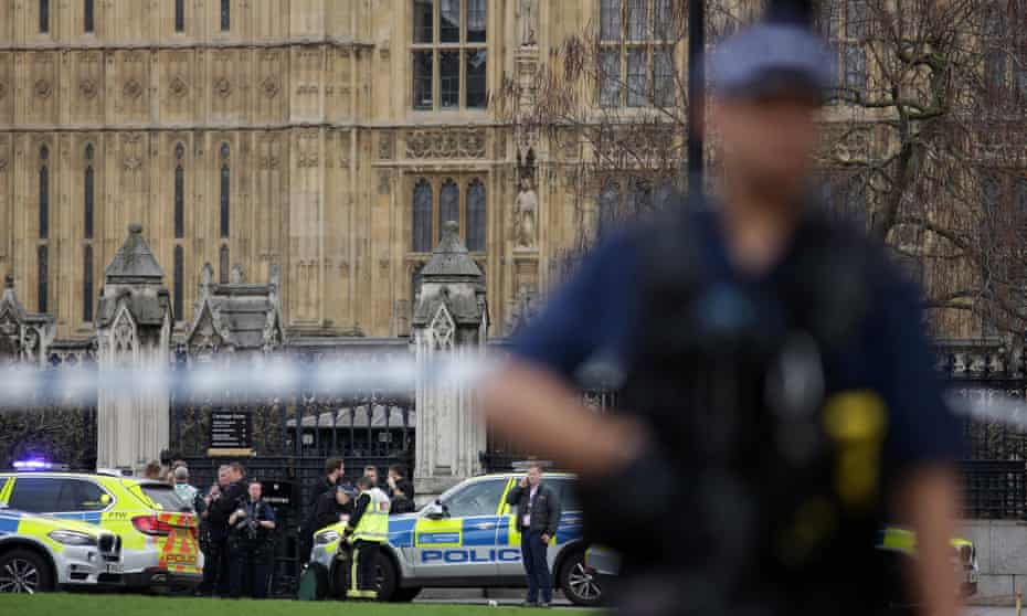 An armed police officer outside the Houses of Parliament after the attack.