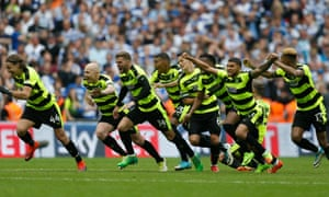 Huddersfield's players celebrate after winning their first promotion to the Premier League.