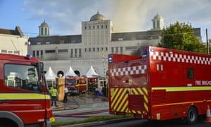 Fire crews tend to blaze at Baitul Futuh Mosque in Morden