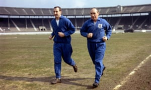 Byrne jogging with Alf Ramsey, right, in 1963.
