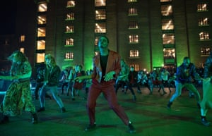 Professional dancers dressed as zombies perform Michael Jackson's Thriller in front of Granary Square to celebrate Halloween in London