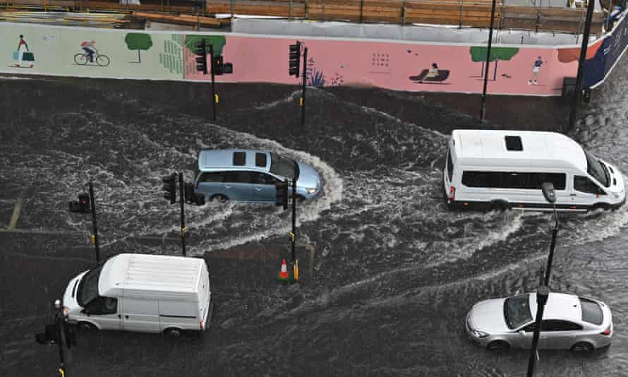 flooded road with four vehicles