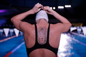 Margherita Panziera from Italy and the Aqua Centurion team with a lion tattoo as she prepares to warm up between races.