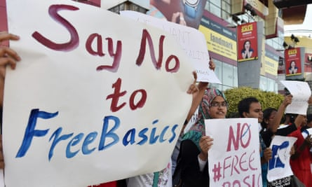 Indian demonstrators hold placards during a protest against Facebook's Free Basics initiative in Bangalore.