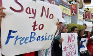 Indian demonstrators of free software movement Karnataka hold placards during a protest against Facebook's Free Basics initiative in Bangalore.