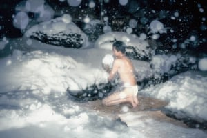 A participant performs cold-water ablutions in a lake.