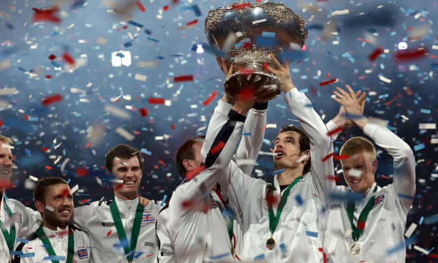 Great Britain's Andy Murray lifts the Davis Cup in 2015 as his team-mates look on.