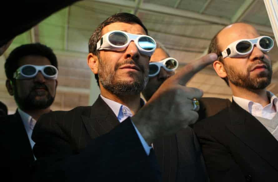 Iranian President Mahmoud Ahmadinejad tours an exhibition on laser technology in Tehran in 2010.