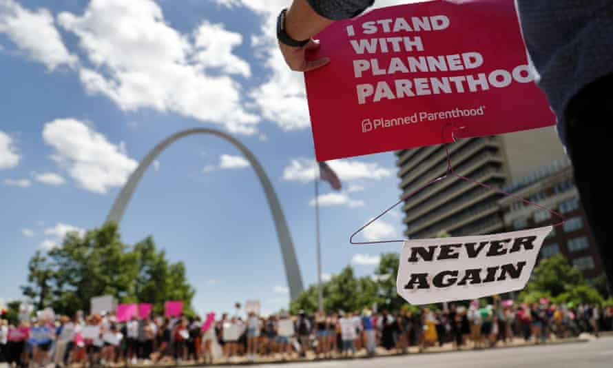 Abortion-rights supporters stand on both sides of a street near the Gateway Arch as they take part in a protest in favor of reproductive rights in St. Louis.