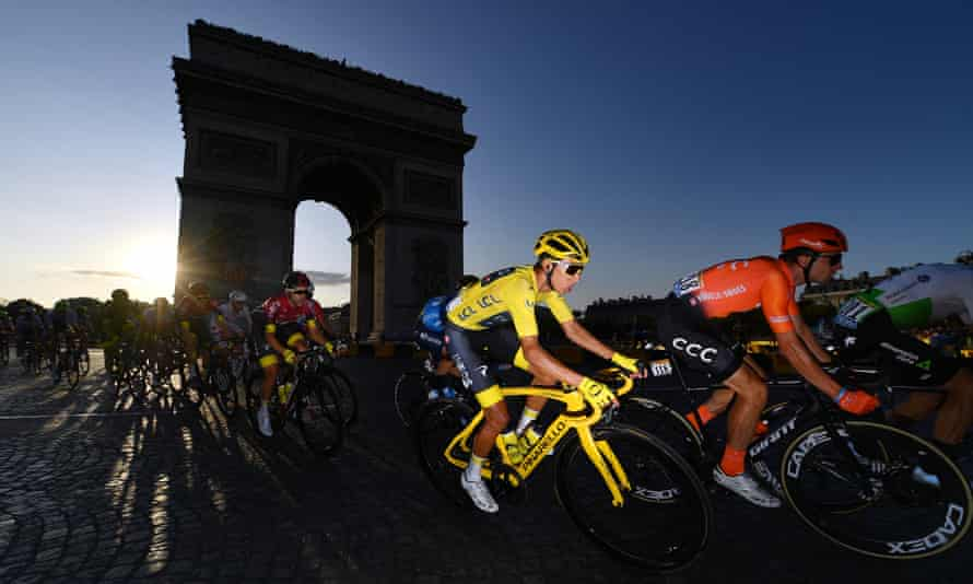 Egan Bernal of Team INEOS sweeps past the Arc de Triomphe on the final stage.