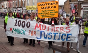 A 2013 demonstration in London against welfare cuts including a benefit cap trial.