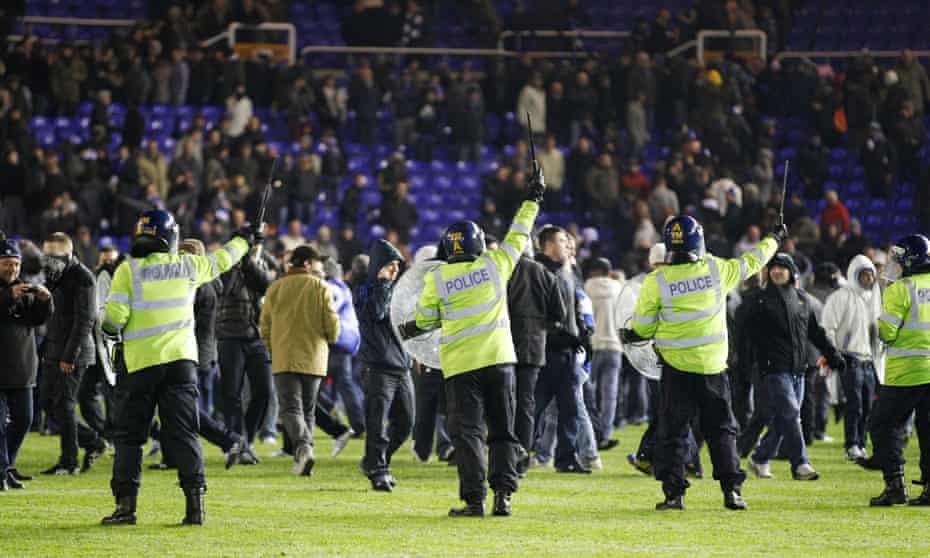 Riot police try to control fans after Birmingham beat Aston Villa at St Andrews.