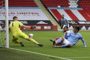 Sheffield United's goalkeeper Aaron Ramsdale makes a smart save from Manchester City's Ferran Torres.
