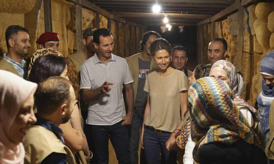 Syria's president, Bashar al-Assad, and his wife Asma, during a visit in 2018 to a tunnel dug by rebels in Jobar, near Damascus.