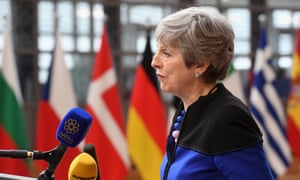 Theresa May speaking to reporters as she arrived at the EU summit.