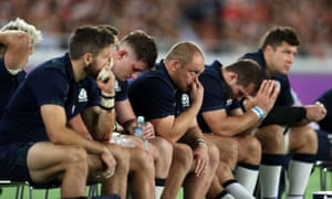 Scotland players look dejected on the bench