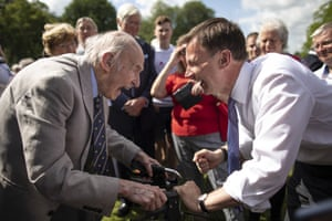 Alton, UK The foreign secretary and Conservative leadership contender, Jeremy Hunt, speaks with the long-time party member and president of the Bramshott and Liphook Conservative branch, 96-year-old Tony Rudgard, during a visit to Chawton House, Hampshire