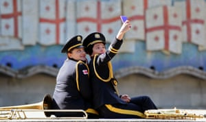Members of a military band take a selfie at the Tomb of the Unknown Soldier in Tbilisi, Georgia