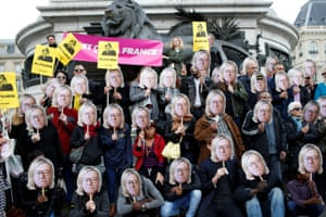 Paris, France Activists wear masks depicting the face of Jean-Marie Le Pen, the founder of the French far-right National Front, with the hair of his daughter Marine Le Pen during a demonstration