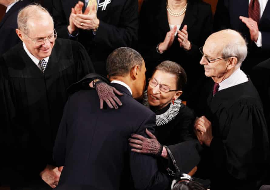 Ruth Bader Ginsburg embracing Barack Obama before his State of the Union address in 2011, with fellow supreme court justices Anthony Kennedy, left, and Stephen Breyer.