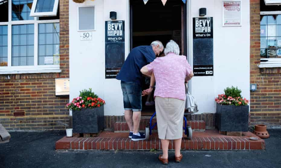 An elderly couple make their way into the Bevy in Bevendean, Brighton