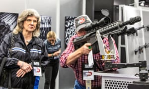 A man and woman browse the guns on display at the NRA convention in Dallas, Texas.