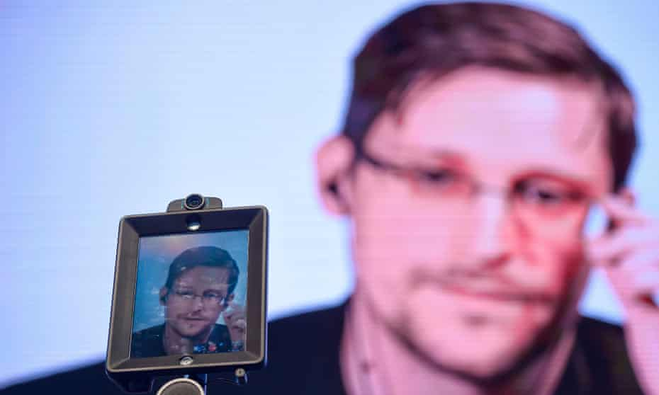 Edward Snowden speaks via video at a conference in Portugal in 2017. The 37-year-old is currently in Russia.