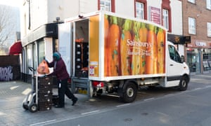 A Sainsbury's supermarket delivery van and driver seen on empty streets in Brick Lane, east London, Britain, 27 March 2020.