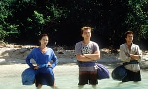 Leonardo DiCaprio, centre, Guillaume Canet, right and Virginie Ledoyen, left, n a scene from The Beach.