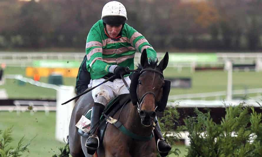 JT McNamara, aboard Garde Champetre, jumps the last on their way to victory at Cheltenham in December 2011.