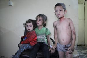 Wounded Syrian children wait to receive treatment at a hospital following a reported airstrike on the rebel-held northwestern city of Idlib
