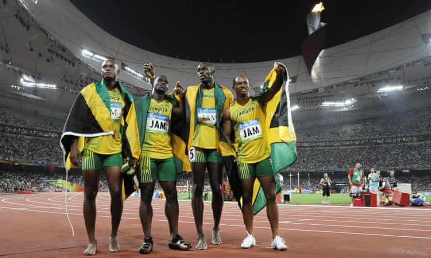 Jamaica's Asafa Powell, Nesta Carter, Usain Bolt and Michael Frater celebrate after winning the men's 4x100m relay at the 2008 Olympic Games in Beijing