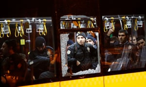 Police officers stand inside a damaged bus after the bomb attacks outside Besiktas's stadium that killed 38 people last year.