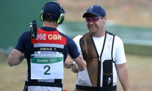 Great Britain's Tim Kneale and Steven Scott (right) shake hands ahead of the men's double trap bronze medal match, which Scott eventually won.