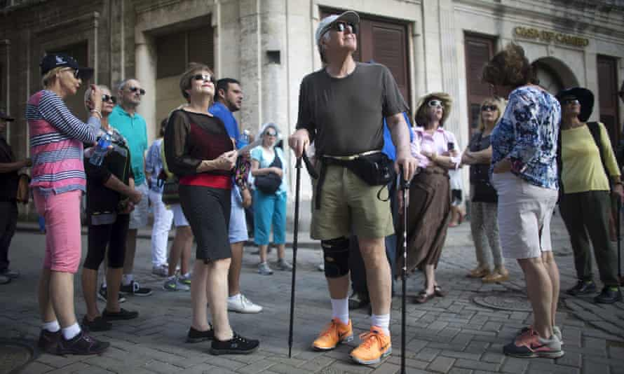 American tourists look around during a tour of Old Havana.